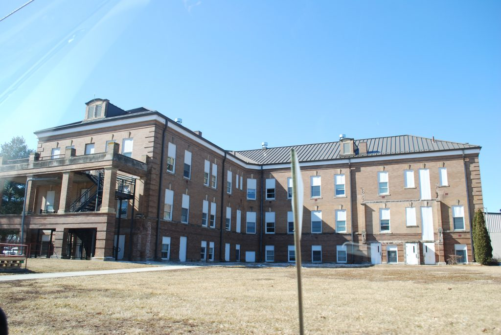 Exterior image of Clarinda Academy a large old 3 story building