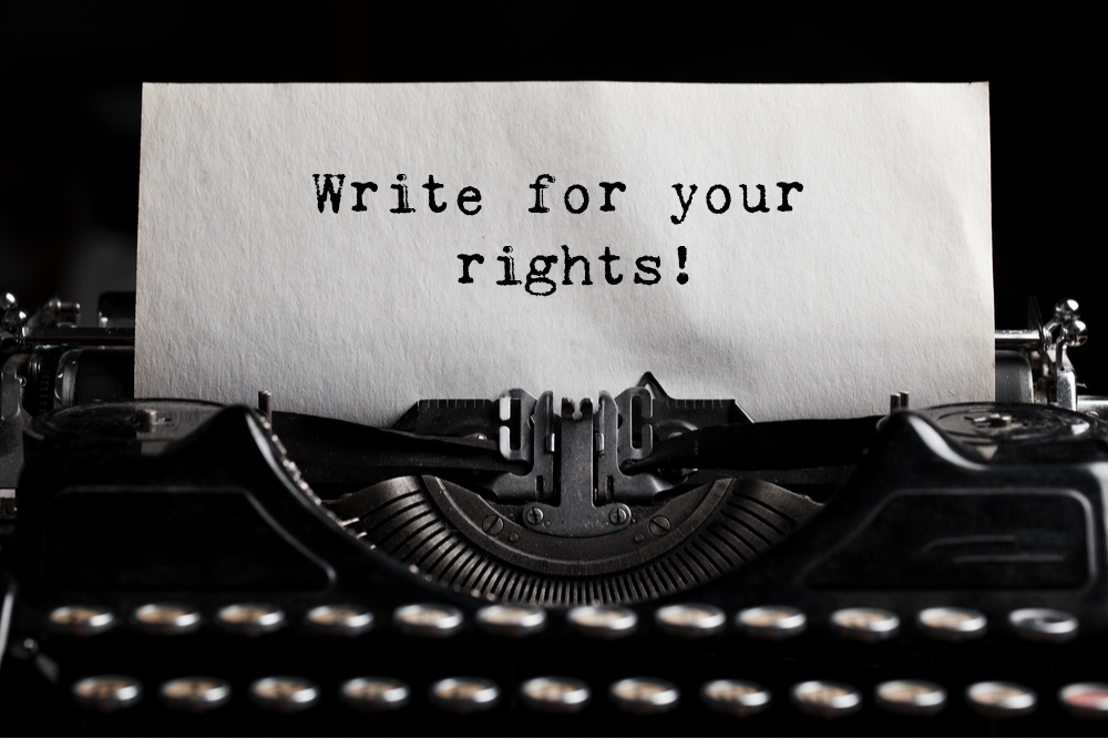 "Black and white photo of a typewriter with a piece of paper with the words, ""Write for your rights!"""