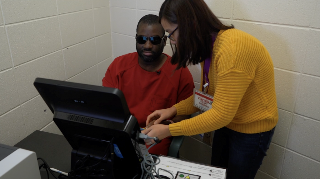 Image: Jordan learns how to use an Accessible Voting Unit from a King County Elections staff, allowing him to later vote with privacy and dignity.